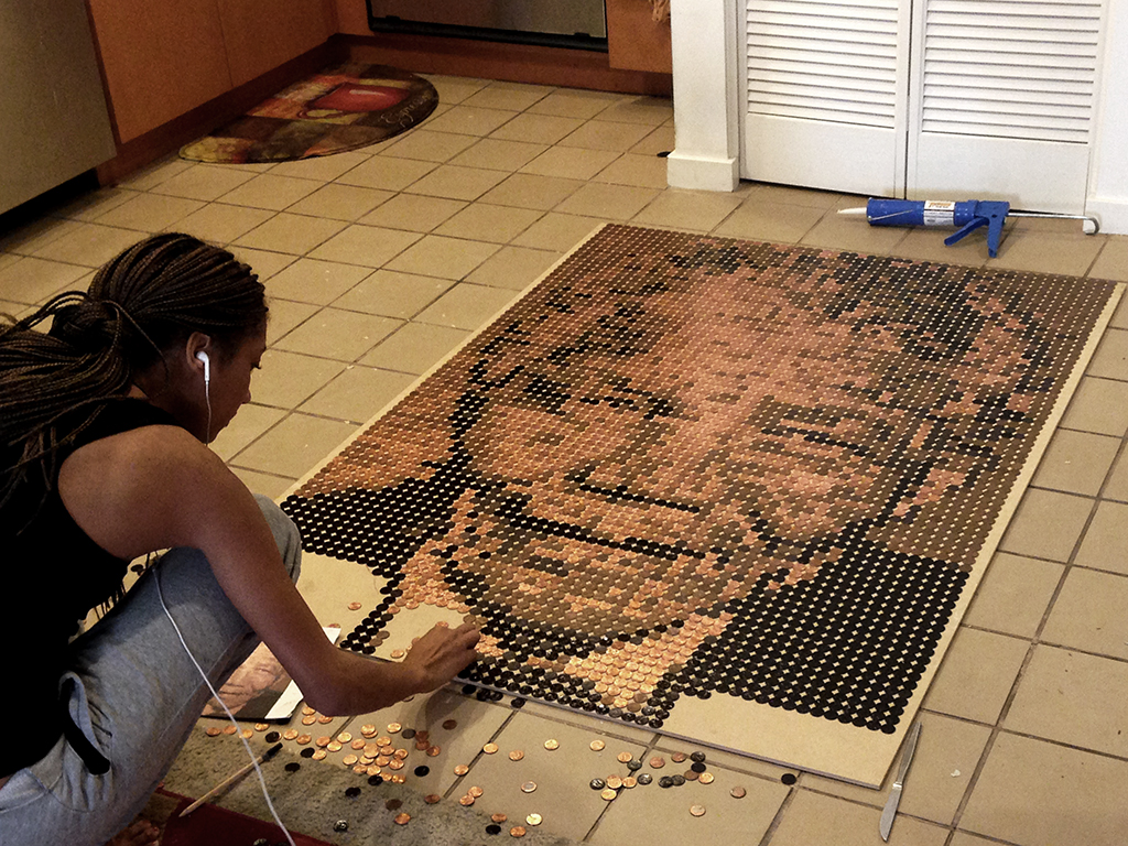 Talia working on Mandela portrait